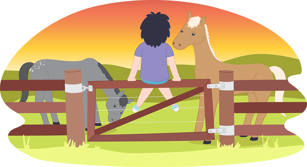 Child sitting on fence looking at horses at sunset