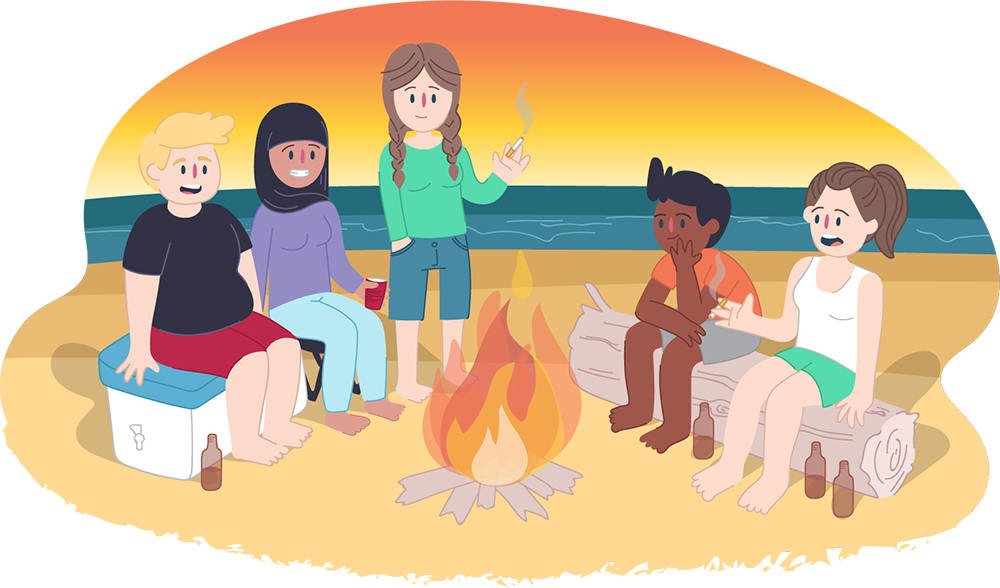 Group of teens around campfire at the beach
